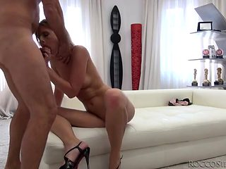 Skinny naked cocksucker in heels blows Rocco Siffredi