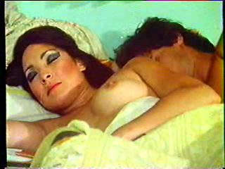 Vintage lady woken up for sex by her husband on bed