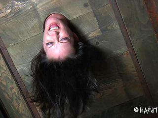 BDSM porn shoot of brunette slave yelling when spanked