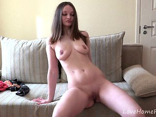 Busty brunette gets naked and displays her body
