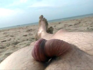Naked on public beach