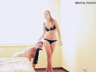Dominant chick puts the strap-on on her servant's head